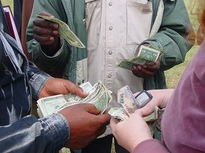 Money Changing at the Border by Amalthya